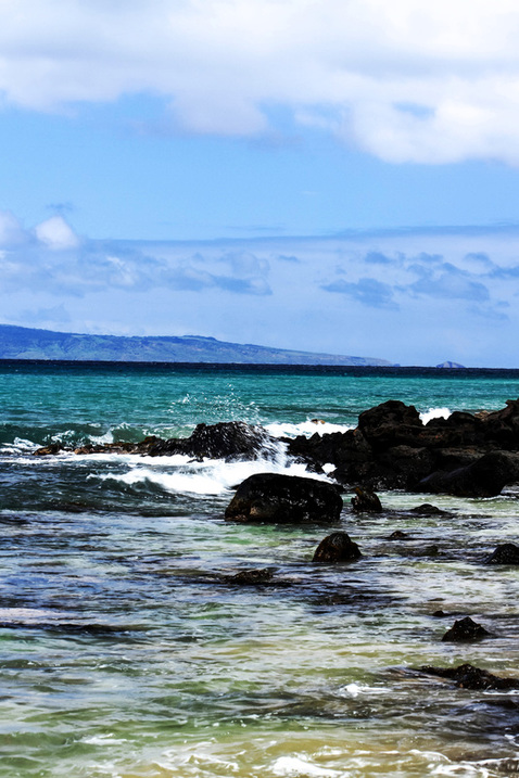 The beautiful blues and green of the Pacific Ocean captured in a photograph from Maui